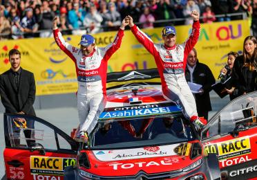 Winners of WRCRALLYRACC CATALUNYA 2018, Sebastien Loeb and Daniel Elena on top of their Citroën C3 WRC.